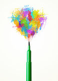 Felt pen close-up with colored paint splashes Royalty Free Stock Photos