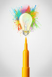 Felt pen close-up with colored paint splashes and lightbulb Royalty Free Stock Image