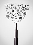 Felt pen close-up with social media icons Royalty Free Stock Photography