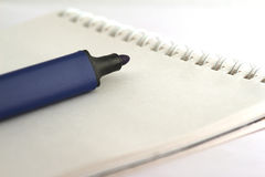 Felt pen on a notebook Stock Images