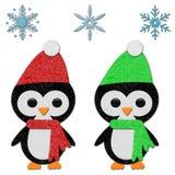 Felt Penguins. Cute felt penguin set with snowflakes Royalty Free Stock Image