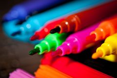 Felt pens bright, colorful on a dark background royalty free stock photography
