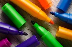 Felt pens. Colorfull felt-tips pens on wooden background stock images
