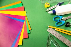 Stationery for school on a green background stock image