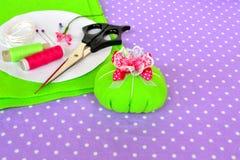 Felt pin cushion, idea for handmade crafts. Scissors, thread, needles, pins, paper templates - sewing kit Stock Photography
