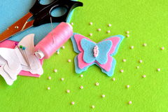 Felt pink and blue butterfly. Paper butterfly patterns, scissors, beads, thread, needle, pins. Felt decoration. Summer kids crafts stock photo