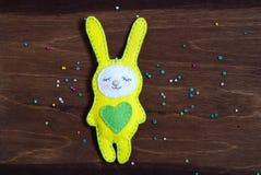 Felt rabbit on a wooden background royalty free stock photos