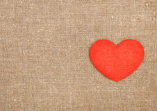 Felt red heart on the burlap Royalty Free Stock Photography