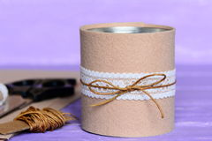 Felt and ribbon recycled tin can. Creative recycling tin cans into holder for office supplies. Thrifty, quick and simple idea Stock Photo