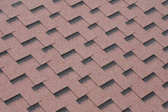 Felt roofing. Red mineral felt roofing shingles texture stock photography