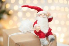 Felt Santa claus. Sitting on a gift box Stock Image