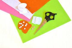 Felt sheets, paper templates, scissors, pins, felt details - sewing set for the felt mushroom. Tutorial Stock Photo