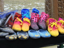 Felt shoes. Hand made colorful felt shoes for street sale, Lithuania stock photography