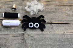 Felt spider ornament for Halloween decor, craft set on a vintage wooden background with copy space for text Royalty Free Stock Images
