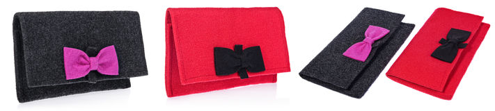 A felt, textile ladies handbags, handmade purses with bows in th Royalty Free Stock Images