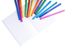Felt-tip markers on copybook isolated Stock Photo