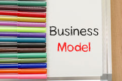 Felt-tip pen and whiteboard and business model text concept. Felt-tip pen and whiteboard on a wooden background and text concept Royalty Free Stock Photography
