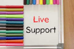 Felt-tip pen and whiteboard and live support text concept. Felt-tip pen and whiteboard on a wooden background and text concept Royalty Free Stock Photo