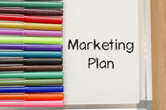Felt-tip pen and whiteboard and marketing plan text concept. Felt-tip pen and whiteboard on a wooden background and text concept Royalty Free Stock Images