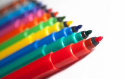 Felt-tip pens. A row of coloured felt-tip pens on white background Royalty Free Stock Photos