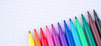 Felt-tip pens on a notebook. Colorful felt-tip pens on a notebook royalty free stock photography