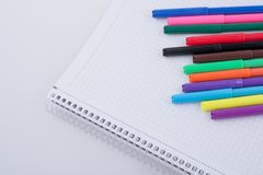 Felt-tip pens on a notebook. Colorful felt-tip pens on a notebook royalty free stock photos