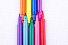 Felt-tip pens on a notebook. Colorful felt-tip pens on a notebook stock images