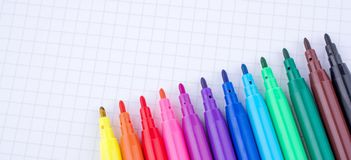 Felt-tip pens on a notebook. Colorful felt-tip pens on a notebook stock image