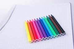 Felt-tip pens on a notebook. Colorful felt-tip pens on a notebook stock photos