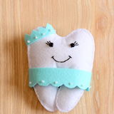 Felt tooth fairy doll  on wooden background. Cute felt tooth fairy for small kids. Handmade children`s stuffed toy idea Royalty Free Stock Image