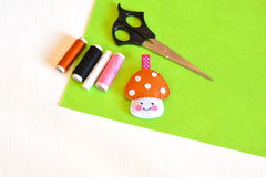 Felt toy mushroom, thread, needle, scissors. Tutorial Stock Photo