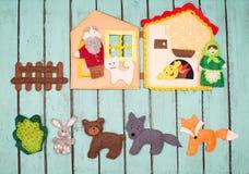 Felt toys story fairy tale. Handmade felt toys over wooden rusti. C background Stock Photos