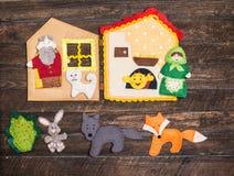 Felt toys story fairy tale. Handmade felt toys over wooden rusti Stock Image