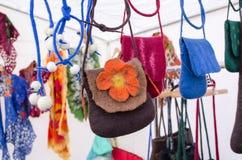 Felt wool girl bag sold outdoor street market fair Stock Photos