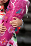 Felted school cone in hands. Felted handmade school cone with floral decoration held by a pre-schooler girl stock image