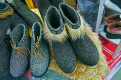Felted shoes. Traditional Russian felted shoes on shelf Stock Photo