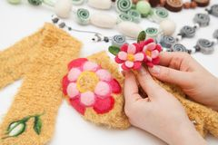 Felting activity. Felted flower in woman's hands Stock Image
