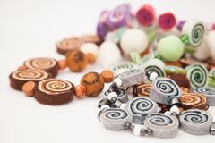Felting activity. Felted necklaces on the white Royalty Free Stock Images