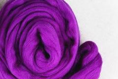 Felting wool. Purple wool Stock Photos