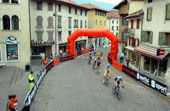 Feltre, Italy:  Bicyclists Racing in Medieval City Stock Photo