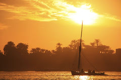 Felucca boat sailing on the Nile river at sunset, Luxor Royalty Free Stock Photography