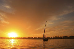 Felucca boat sailing on the Nile river at sunset, Luxor Stock Image