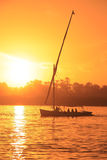 Felucca boat sailing on the Nile river at sunset, Luxor Stock Photo