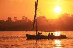 Felucca boat sailing on the Nile river at sunset, Luxor Stock Images