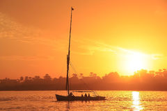 Felucca boat sailing on the Nile river at sunset, Luxor. Egypt Royalty Free Stock Photos
