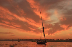 Felucca boat sailing on the Nile river at sunset, Luxor Stock Photography