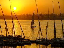 Felucca boats at the harbor at sunset, Luxor Royalty Free Stock Photography
