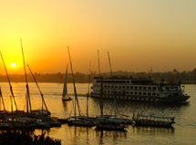 Felucca boats at the harbor at sunset, Luxor Stock Images