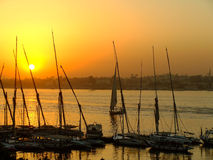 Felucca boats at the harbor at sunset, Luxor Royalty Free Stock Photos