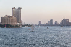 Felucca boats on the Nile. Cairo, Egypt - May 26, 2016: Felucca boats sailing on the Nile river in central Cairo at dusk Stock Photography